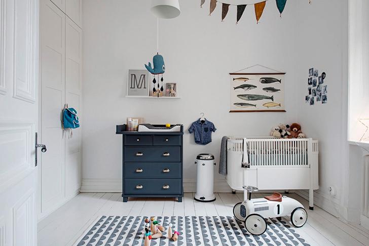 Habitación de Bebé en estilo nórdico con pequeños detalles decorativos